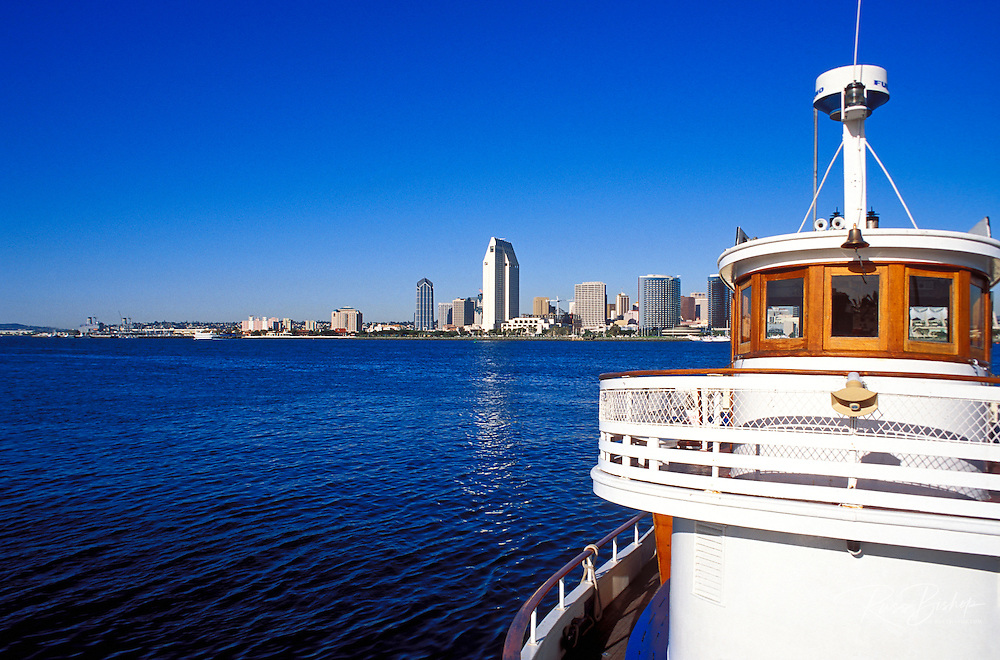 The Coronado Island ferry and the downtown towers across San Diego Harbor, San Diego, California USA