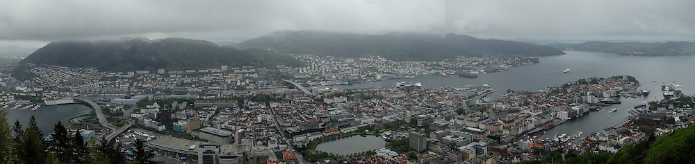 Panoramic views of Bergen, Norway, are seen from the top of Fløyen on May 21, 2013. Access is by the Fløibanen funicular, which takes passengers up the steep grade in a matter of minutes. The Fløytrappen observation deck, restaurant and shops can be found at the summit. People can ride down or walk the wooded pathways back to town.  (© 2013 Cindi Christie)
