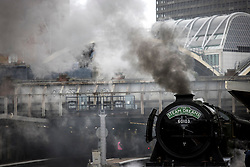 © Licensed to London News Pictures. 20/05/2021. London, UK. The world famous LNER Flying Scotsman steam locomotive bellows smoke and steam as it prepares to leave Victoria Station in central London ahead of a tour through the Surrey Hills in South east England. The heritage steam locomotive touring season was mostly cancelled last year due to the Covid-19 pandemic but is now underway as restrictions are eased. Built in 1923 for the London and North Eastern Railway (LNER)It was the first steam locomotive to reach 100 miles per hour . Photo credit: Ben Cawthra/LNP