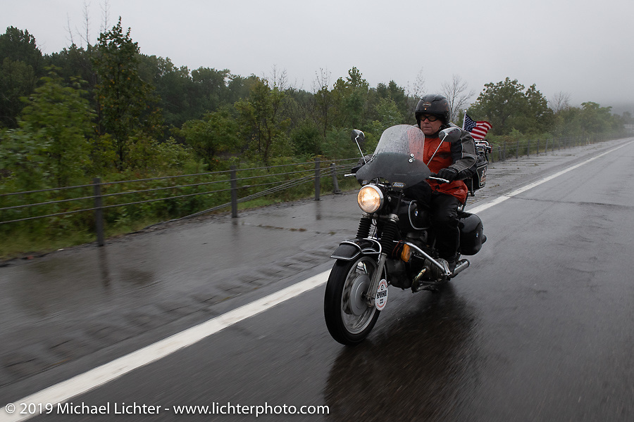 MCR sponsor & Haggarty agent Greg Allen rides through the pouring rain on his '60's BMW during the Motorcycle Cannonball coast to coast vintage run. Stage-3 (227-miles) from Binghampton to Jamestown, NY. Monday September 10, 2018. Photography ©2018 Michael Lichter.