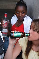 Teenage girls drinking.