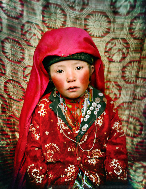 Portrait of Marbet (7 years old), returning from looking over sheep outside. Her red cheecks are due to cold weather.<br /> Campment of Tshar Tash (Haji Osman's camp), in the Wakhjir valley, at the source of the Oxus.<br /> Winter expedition through the Wakhan Corridor and into the Afghan Pamir mountains, to document the life of the Afghan Kyrgyz tribe. January/February 2008. Afghanistan