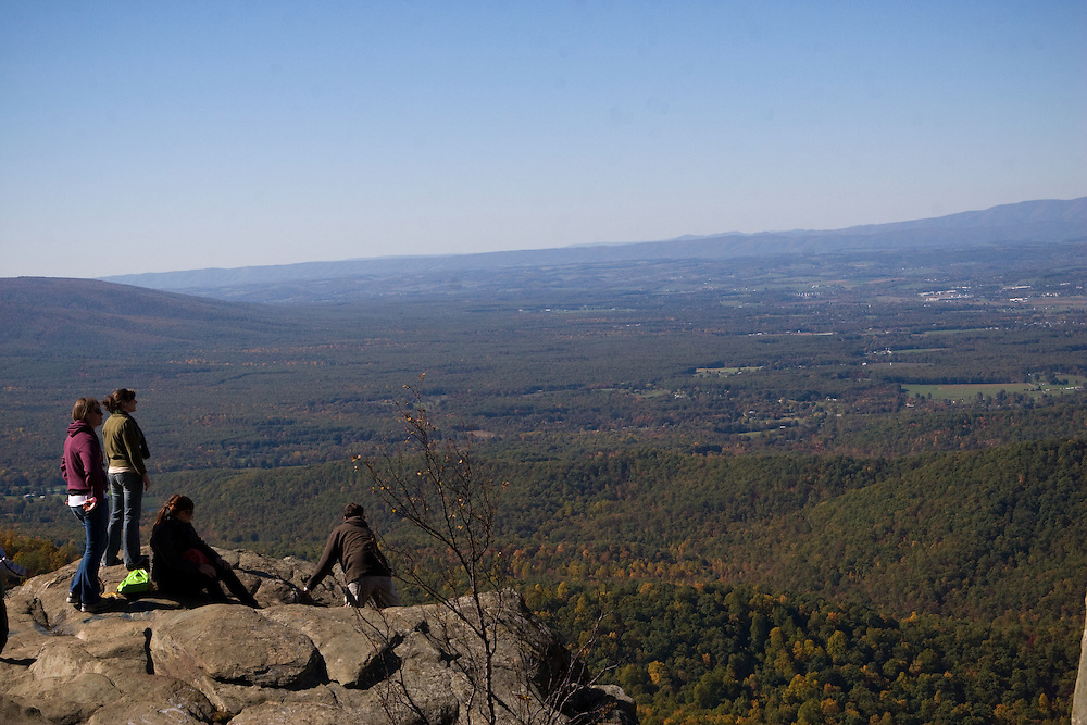 A group of friends take in the view towards Waynesboro atop Humpback Rock in the Blue Ridge Parkway, Virginia.