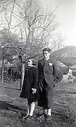 boy and girl posing for photo