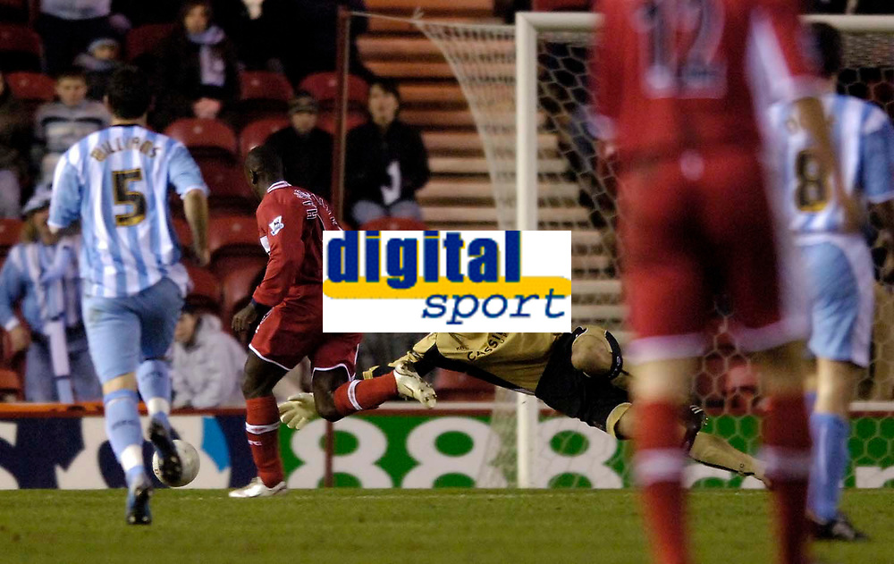 Photo: Jed Wee.<br /> Middlesbrough v Coventry City. The FA Cup. 08/02/2006.<br /> <br /> Middlesbrough's Jimmy Floyd Hasselbaink rounds Coventry goalkeeper Marton Fulop to score the opening goal.