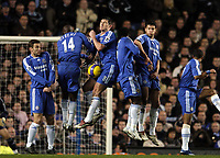 Photo: Olly Greenwood.<br />Chelsea v Arsenal. The Barclays Premiership. 10/12/2006. Chelsea's Frank Lampard stops Arsenal's free kick