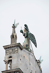 Church roof with angels of San Michele in Lucca, Tuscany, Italy