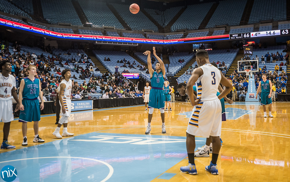 Cox Mill's Wendell Moore (0) shoots free throws in the closing seconds of the NCHSAA 3A State Championship game against Eastern Guilford at the Dean Smith Center in Chapel Hill. Cox Mill won the game 70-66
