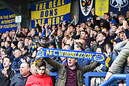 Wimbledon fans celebrate the win against Wycombe Wanderers during the EFL Sky Bet League 1 match between AFC Wimbledon and Wycombe Wanderers at the Cherry Red Records Stadium, Kingston, England on 27 April 2019.