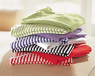 This photograph was created in order to show a color story of all the available colors of these poloshirts in one image.