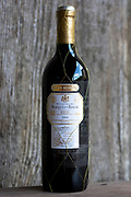 Marques de Riscal Rioja red wine bottles Gran Reserva 2004 vintage by old oak panel, Spain