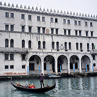 VENICE, ITALY - APRIL 04:  Ê A gondola sails in front of the Fondaco dei Tedeschi sold to Benetton Group and now in the middle of a row due to the planning conversion into a shopping mall on April 4, 2012 in Venice, Italy. Several palaces and historical buildings in Venice have been recently sold by the Municipality or are currently for sale causing local anger.  (Photo by Marco Secchi/Getty Images)