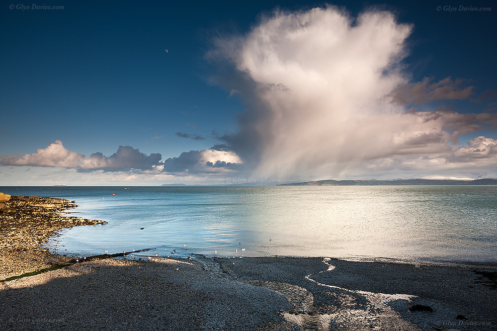 A sudden and MASSIVE squall passed over the small ex fishing cove of Moelfre but clear brilliant low sunshine continued throughout. It was like an enormous explosion rising into the sky.