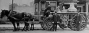 Firemen (from left to right): Captain L.P. Davis, Julius Matison And Albert Erickson. The horses are the famous team of Toby, Ceasar and Spider; Ceasar, in the middle, can't be seen. (Seattle Times archives, 1913)