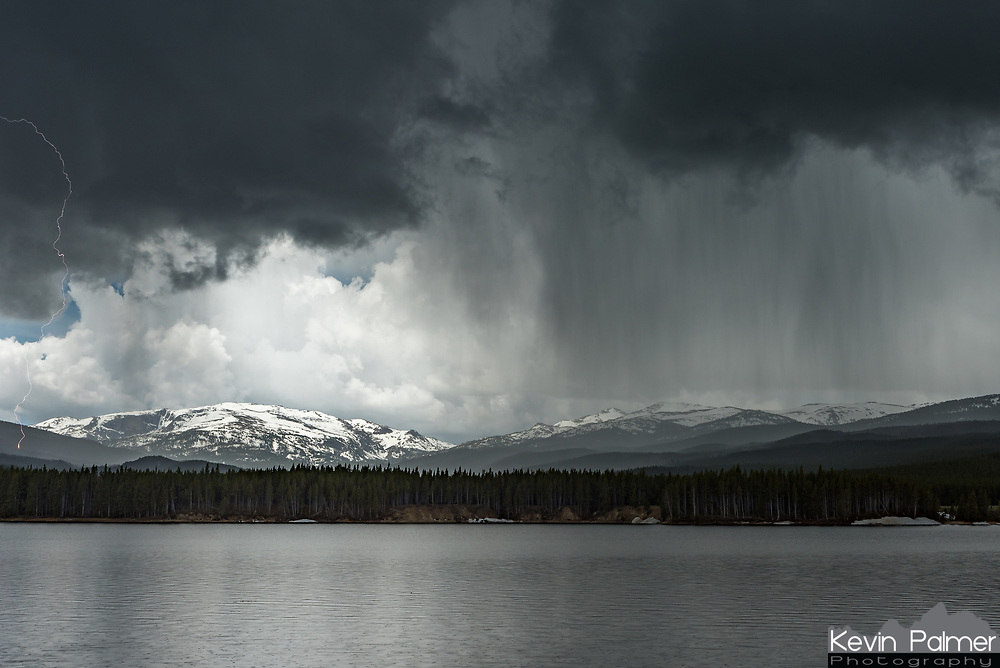 With a cold rain turning into accumulating hail, and lightning striking nearby it wasn't exactly the best weather for fishing. Park Reservoir, located at 8200' in the Bighorn Mountains was just barely reachable, with snow melting off of the rough road days earlier. But soon after arriving here, this storm started brewing before noon. I took shelter in my car to avoid the nearby bolts, but left my camera outside to shoot a time lapse. Lightning is not that difficult to capture at night, but during the day it's a lot harder. With the average bolt lasting for 30 microseconds, and using a shutter speed of 1/320 of a second, the chances of capturing lightning on camera were astronomically small. But after looking at the images later, I found that my camera had somehow captured a strike on the far left. The tree that was struck can even be seen going up in flames, but the rain put it out immediately.