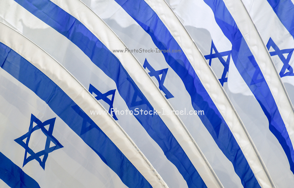 Set of five Israeli flags blowing in the wind