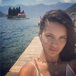 """Adriana Lima releases a photo on Instagram with the following caption: """"\u2b50\ufe0fGospa od Skrpjela\u2b50\ufe0f"""". Photo Credit: Instagram *** No USA Distribution *** For Editorial Use Only *** Not to be Published in Books or Photo Books ***  Please note: Fees charged by the agency are for the agency's services only, and do not, nor are they intended to, convey to the user any ownership of Copyright or License in the material. The agency does not claim any ownership including but not limited to Copyright or License in the attached material. By publishing this material you expressly agree to indemnify and to hold the agency and its directors, shareholders and employees harmless from any loss, claims, damages, demands, expenses (including legal fees), or any causes of action or allegation against the agency arising out of or connected in any way with publication of the material."""