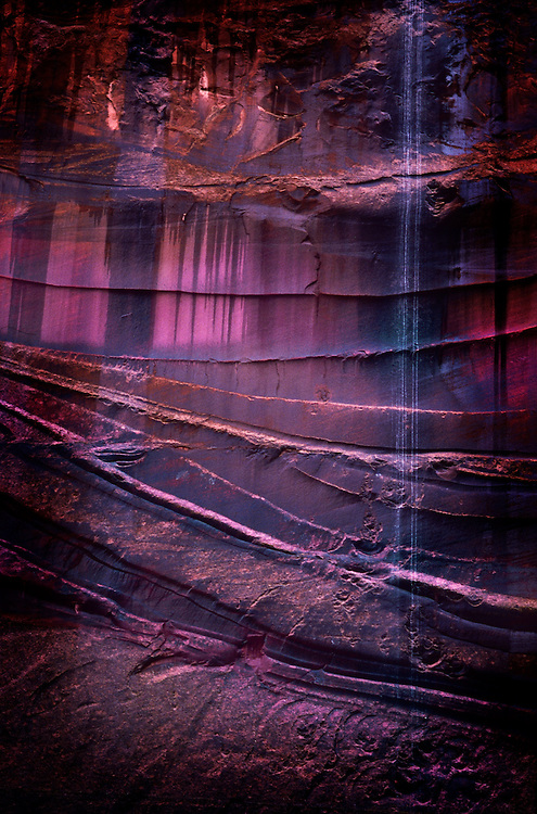 sandstone with desert varnish and trickling waterfall