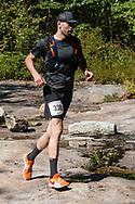 Kerhonkson, New York  - A runner in the 30-mile race follows the trail at Minnewaska State park during the Shawangunk Ridge Trail Run/Hike on Sept. 16, 2017.