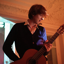 """Jeremy Jay (US) opening for The Walkmen at the """"Soiree de poche #7"""" (pocket night #7): a concert happening in an appartment in Paris, boulevard Magenta near Gare de l'Est. Organised by La Blogotheque.. .Feb. 2009, 11th / photo: Antoine Doyen"""