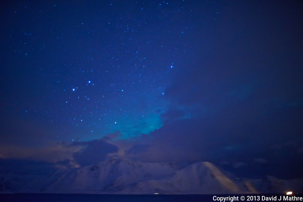 Early Morning (04:22 AM) Glimmer of Northern Lights While Sailing North on the Hurtigruten MV Nordkapp. Image taken with a Nikon D800 and 24 mm f/1.4G lens (ISO 1600, 24 mm, f/1.4, 4 sec).