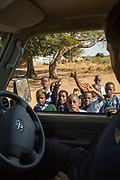 Kids from car interior during safari, South Luangwa National Park, Zambia