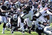 Oakland Raiders running back Latavius Murray (28) leaps over Atlanta Falcons defense at Oakland Coliseum in Oakland, Calif., on September 18, 2016. (Stan Olszewski/Special to S.F. Examiner)