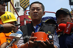 November 1, 2018 - Jakarta, Indonesia - Head of the National SAR Agency, Vice Marshal Syaugi, shows the Lion Air JT610 flight data recorder to media crew on the Baruna Jaya I research vessel at Karawang bay, West java, on November 1, 2018. The join SAR team succesfully find and evacuated the Lion Air B737 Max 8 flight data recorder on the 4th day of SAR operation after the aircraft crash on the Karawang bay, minutes after take off from Jakarta. (Credit Image: © Aditya Irawan/NurPhoto via ZUMA Press)