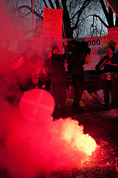 © under license to London News Pictures.  07/12/2010. Protesters set off flares in front of Leinster House in Dublin, Ireland during a demonstration against the Irish budget on 7/12/2010.  Photo credit should read Michael Graae/London News Pictures