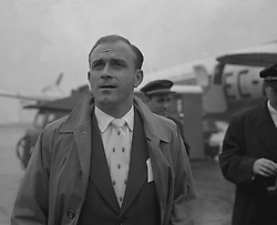 Alfredo Di Stefano, of Real Madrid, arriving at Heathrow Airport for the European Cup semi-final second leg against Manchester United.