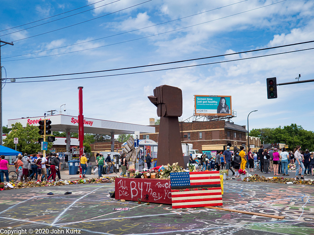 """12 JUNE 2020 - MINNEAPOLIS, MINNESOTA: A part of the impromptu community memorial for George Floyd at the corner of 38th Street and Chicago Ave. in Minneapolis. The intersection is informally known as """"George Floyd Square"""" and is considered a """"police free zone."""" There are memorials to honor Black people killed by police and people providing free food at the intersection. Floyd, an unarmed Black man, was killed by Minneapolis police on May 25 when an officer kneeled on his neck for 8 minutes and 46 seconds. Floyd's death sparked weeks of ongoing protests and uprisings against police violence around the world.          PHOTO BY JACK KURTZ"""