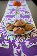 Pan de Muerto, traditional Mexican sweet bread made during Day of the Dead celebrations.