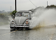 © Licensed to London News Pictures. 29/04/2012. Stapleford, UK . A car drives through flooding in Tawney, Stapleford, Essex. Torrential rain has lead to flooding in parts of the country today 29 April 2012. Photo credit : Stephen Simpson/LNP