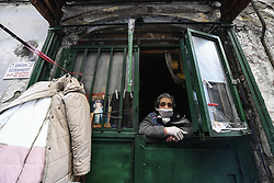 Elderly woman wearing a protective mask, out the door of her home, after a government decree declaring all of Italy a protected area to combat covid-19 coronavirus infection. Naples, Italy on March 14, 2020. Photo by Salvatore Laporta/IPA/ABACAPRESS.COM