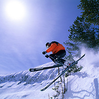 SKIING, Big Sky, MT. Patrick Shanahan (MR) skis glade below Triple Chair.