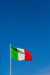 Sorrento, Italy, September 17 2017. An Italian flag flies in the breeze against a clear blue sky in Sorrento, Italy. © Paul Davey