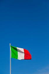 Sorrento, Italy, September 17 2017. An Italian flag flies in the breeze against a clear blue sky in Sorrento, Italy. © Paul Davey
