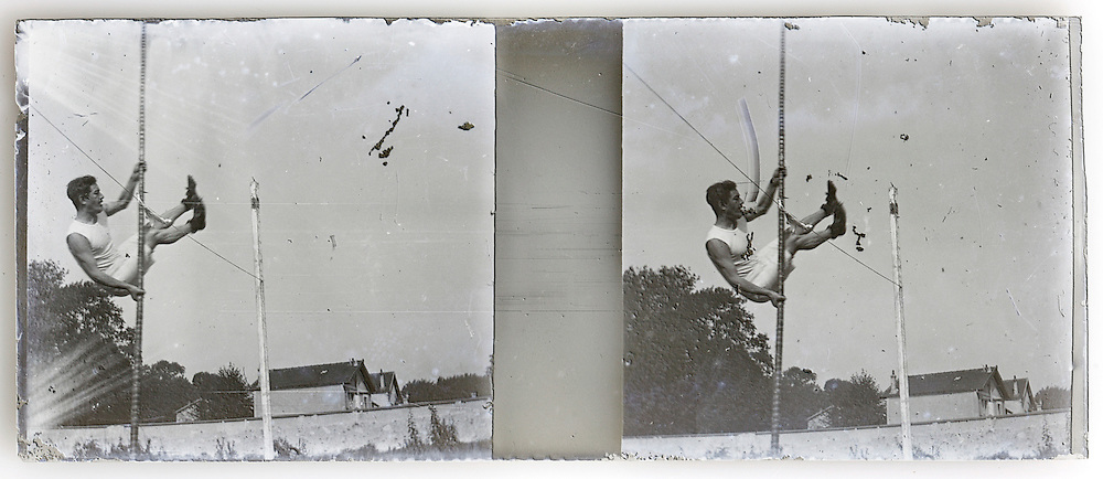 stereo image of athlete making a pole vault jump