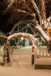 """""""Downtown Truckee 11"""" - Photograph of a snow covered sidewalk and Christmas lights in front of a building in Downtown Truckee, California. Photographed in the early morning."""