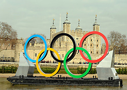 © Licensed to London News Pictures. 28/02/2012, London, UK. The rings in front of The Tower of London. Giant Olympic rings measuring 11 metres high by 25 metres wide are floated down the River Thames on a barge, marking 150 days to go to the start of the London 2012 Olympic and Paralympic Games. Photo credit : Stephen Simpson/LNP