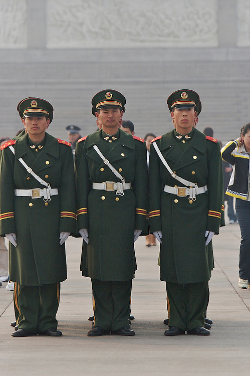 Soldiers at Tiananmen Square gather before the shift change in Beijing, China.