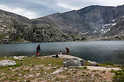 Hikers relax beside Lost Twin Lakes, Big Horn National Forest, Ten Sleep, Wyoming.