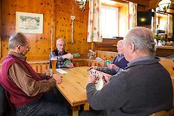 THEMENBILD - Das Kartenspiel Bauernschnapsen (auch Viererschnapsen) ist eine erweiterte Form des Schnapsens, bei dem 4 Spieler teilnehmen. Diese Form des herkömmlichen Schnapsens ist vor allem in Österreich weit verbreitet. Hier im Bild, v.l. Josef Bauernfeind, Josef Heidenberger, Peter Unterweger und Simon Bauernfeind bei einer Partie Bauernschnapsen. Aufgenommen im Gasthof Ködnitzhof am 8. April 2015 in Kals am Grossglockner // The card game Bauernschnapsen is an advanced form of Schnapsen at which 4 players participate. This form of conventional Schnapsens is particularly widespread in Austria. Recorded at Gasthof Ködnitzhof on April 8, 2015. Kals am Grossglockner, Austria. EXPA Pictures © 2015, PhotoCredit: EXPA/ Johann Groder