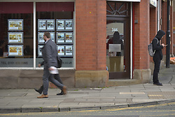 October 19, 2016 - Manchester, England, United Kingdom - People pass an estate agent on October 19, 2016 in Manchester, England. The United Kingdom's finance industry regulator, the Financial Conduct Authority, has announced a commitment to consult on mortgage payment shortfall remediation guidance. (Credit Image: © Jonathan Nicholson/NurPhoto via ZUMA Press)