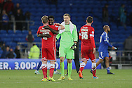 Cardiff players (l-r) Aron Gunnarsson, Bruno Ecuele Manga and David Marshall celebrate their victory at the full time whistle.<br /> <br /> Skybet Football League Championship match, Cardiff City v Ipswich Town at the Cardiff city stadium in Cardiff, South Wales on Tuesday 21st October 2014<br /> pic by Mark Hawkins, Andrew Orchard sports photography.