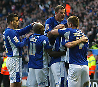 Photo: Steve Bond/Richard Lane Photography. Leicester City v Sheffield Wednesday. Coca Cola Championship. 12/12/2009. Andy King (buried) is congratulated
