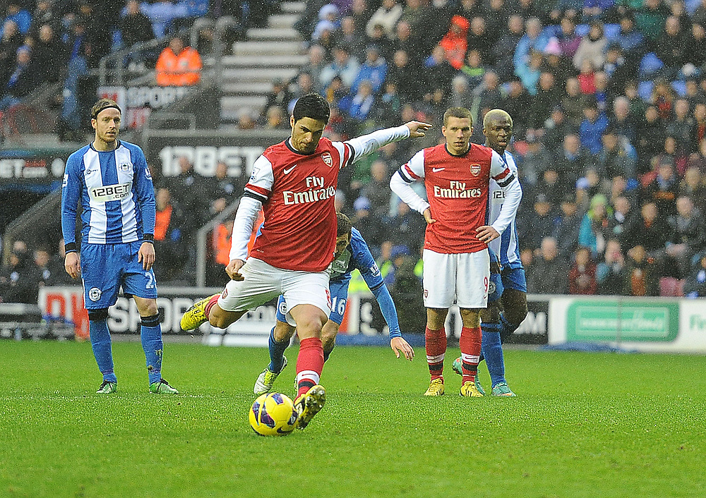 Arsenal's Mikel Arteta scores the only goal of the match from a penalty after with team-mate Theo Walcott was fouled in the area by Wigan Athletic's Jean Beausejour ..Football - Barclays Premiership - Wigan Athletic v Arsenal - Saturday 22nd December 2012 - DW Stadium - Wigan..