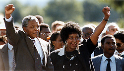 Feb. 11, 1990 - Paarl, South Africa - NELSON MANDELA and WINNIE MANDELA raise their fists to salute a cheering crowd after his release from Victor Verster prison. (Credit Image: © Aftonbladet/IBL/ZUMAPRESS.com)