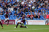 Nathaniel Mendez-Laing of Cardiff city shoots and scores his teams 3rd goal. EFL Skybet championship match, Cardiff city v Aston Villa at the Cardiff City Stadium in Cardiff, South Wales on Saturday 12th August 2017.<br /> pic by Andrew Orchard, Andrew Orchard sports photography.