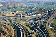 Nederland, Noord-Holland, Amsterdam, 11-12-2013; Knooppunt Coenplein, A8 (Coentunnelweg) en A10 (Ringweg Noord). In de oksel van het verkeersplein bedrijventerrein Bombraak, Oostzaan in de achtergrond.<br /> Coenplein, junction near Zaandam  - North Amsterdam.<br /> luchtfoto (toeslag op standaard tarieven);<br /> aerial photo (additional fee required);<br /> copyright foto/photo Siebe Swart.
